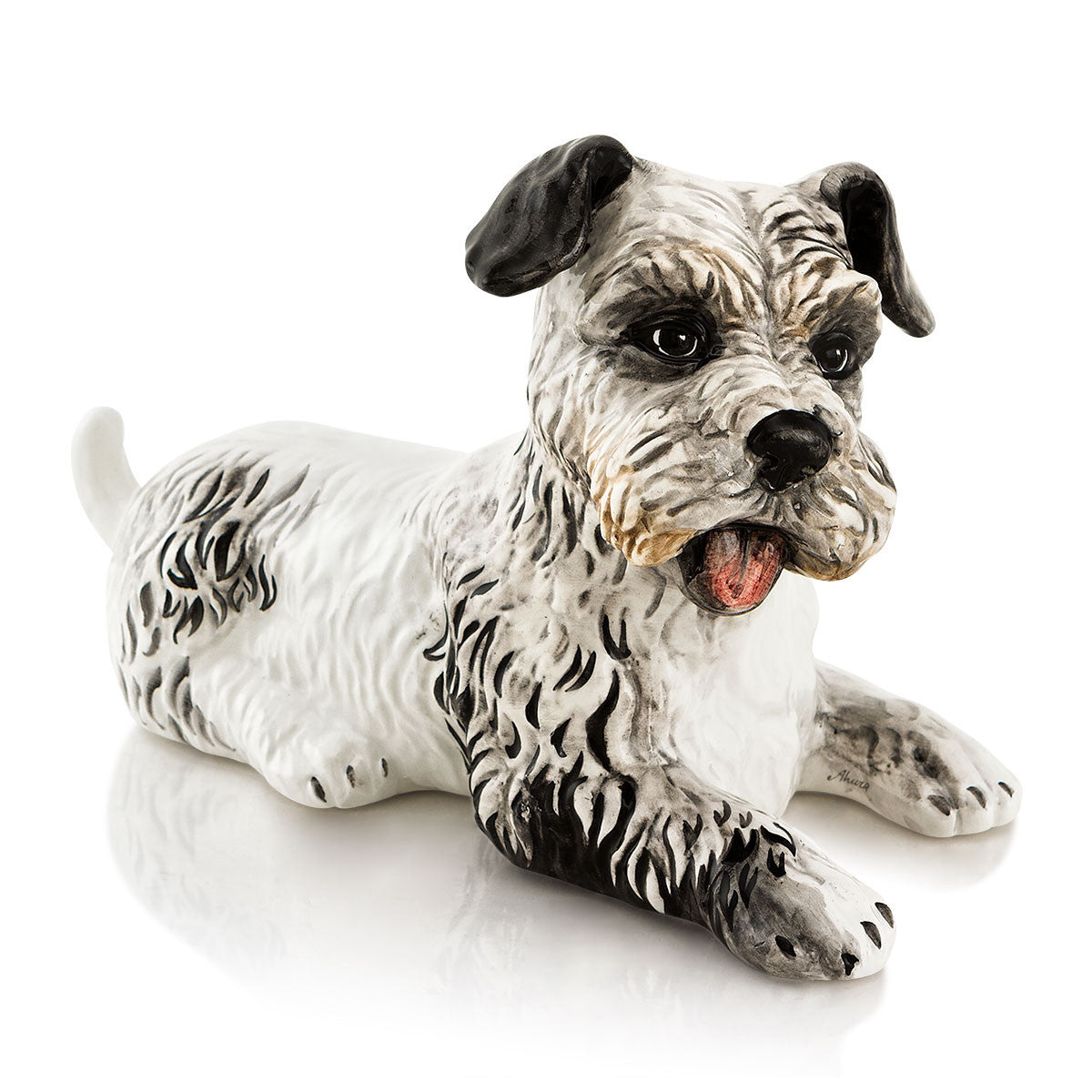 Ceramic scottish terrier statue lying down with lifelike details