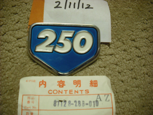 Honda CB250 Aquamarine Sidecover Badge NOS New 871-28-286-010 sku 3112