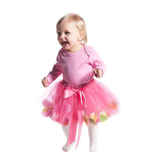 toddler wearing pink fairy tutu skirt with tulle and flower petals