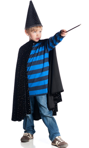 Boy dressed up as wizard pointing magic wand