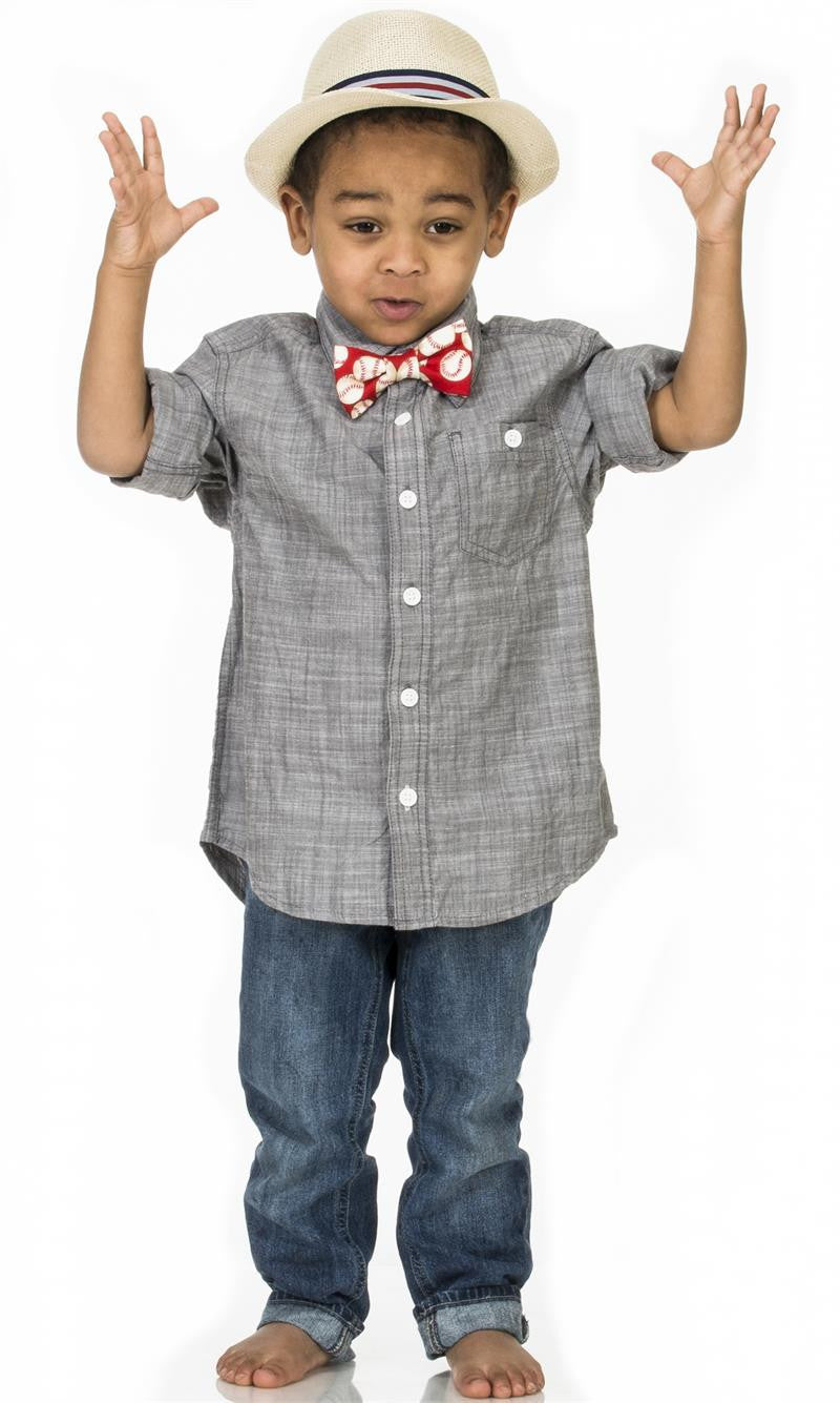 Boy wearing Fly Guy bowtie in blue soccer print