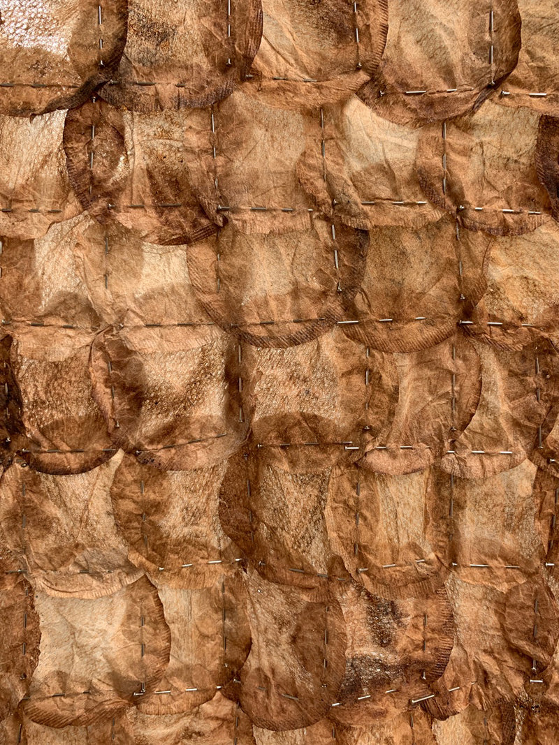 Contemporary fine art textile made of tea bags and pins