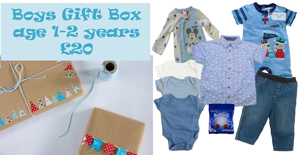 A specially decorated gift box full of items for a little guy aged 1-2 years. Ideal for a first birthday party or different Easter gift. Box includes: Pack of 3 baby vests age 12/18m Boys 100% cotton shirt age 12/18m Boys elasticated waist 100% cotton jeans age 12/18m Zipzap short sleeved/legged romper age 12/18m Disney Mickey Mouse sleepsuit age 18/24m A little sweet treat (item may vary)