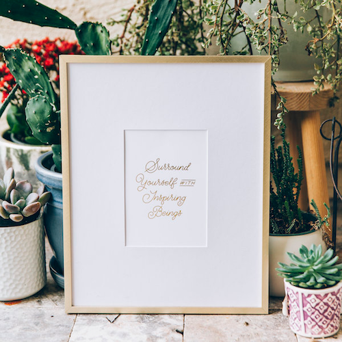 Surround Yourself Print by Lumitory in Gold Frame Amidst Succulents