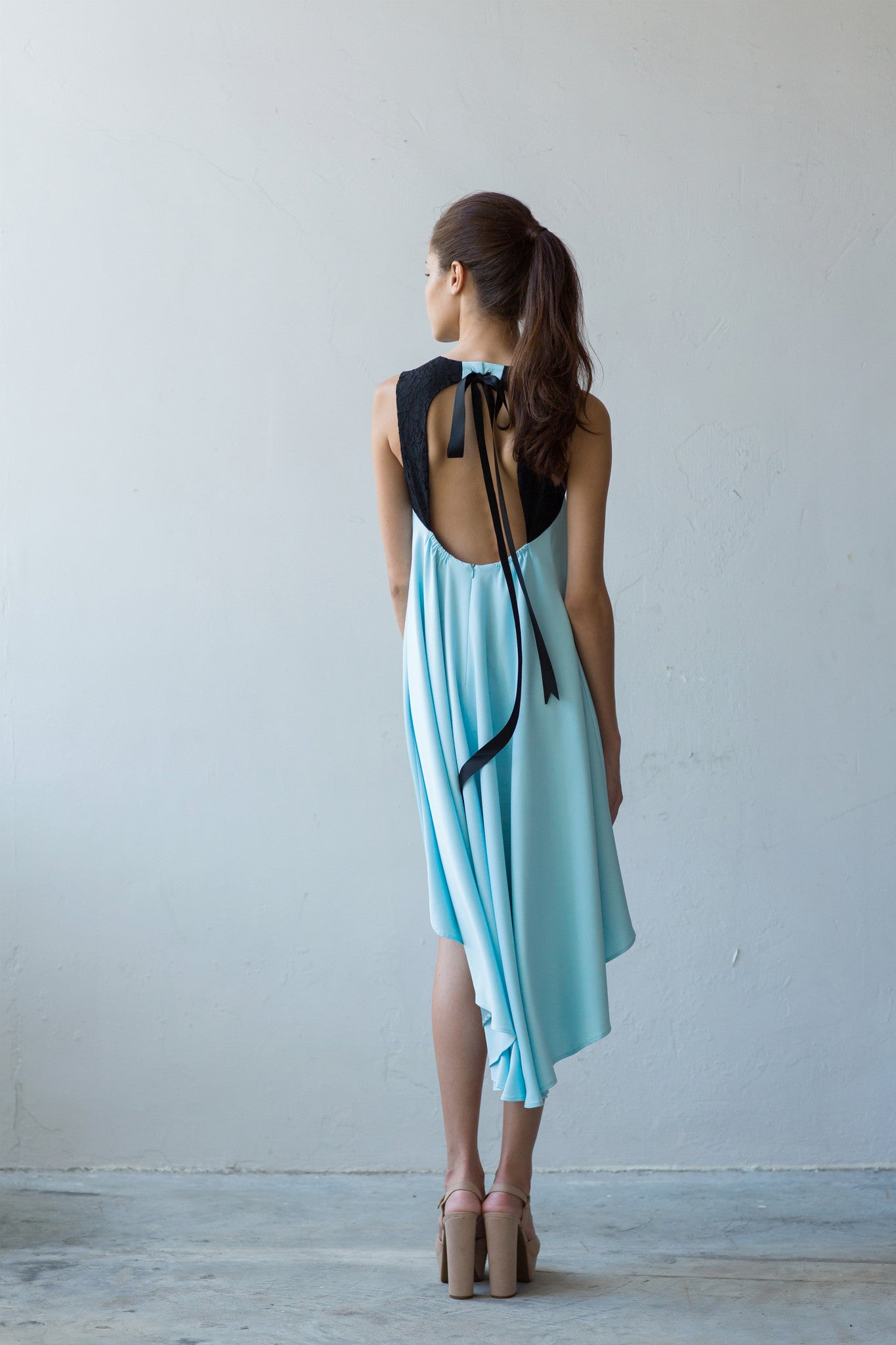 Open back flare dress with asymmetrical hem in sky blue