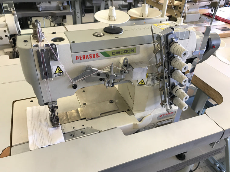 PRE-OWNED PEGASUS CW500-SERIES FLATBED COVERSTITCH AUTOMATIC (ELECTRIC)