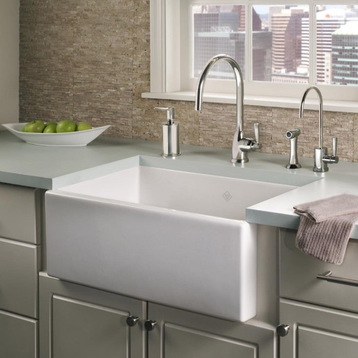 Rohl fireclay farmhouse sink with bridge faucets and counter top