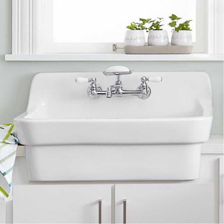 American standard country front apron porcelain sink in laundry room
