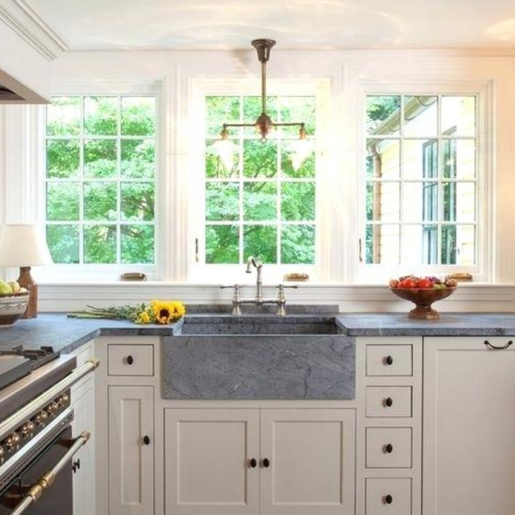 Country grey stone farmhouse sink installed with window