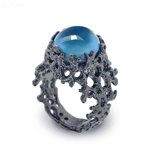 Coral Blue Topaz Black Ring