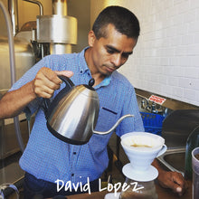 Coffee farmer David Lopez pouring water from a kettle to brew a pour over