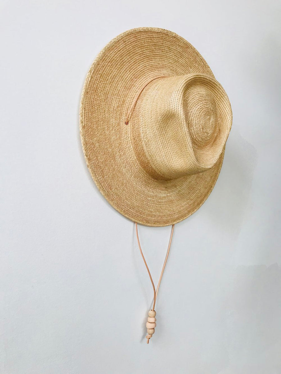 Fair trade palm hat by West Perro with Guatemalan palm perfect for any outdoor adventure or festival and sold by Thread Spun