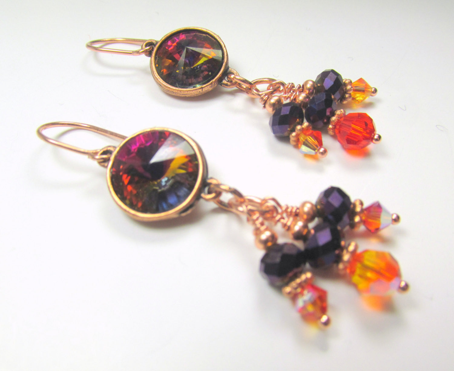 Swarovski Rivoli Volcano Crystal Earrings set in Copper Settings with Fire Opal Orange and Metallic Purple Crystals - Odyssey Creations