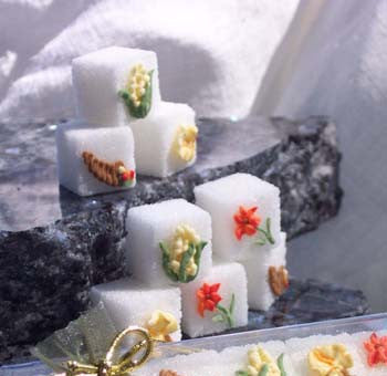 Decorated sugar cubes with corn, flowers, cornucopias