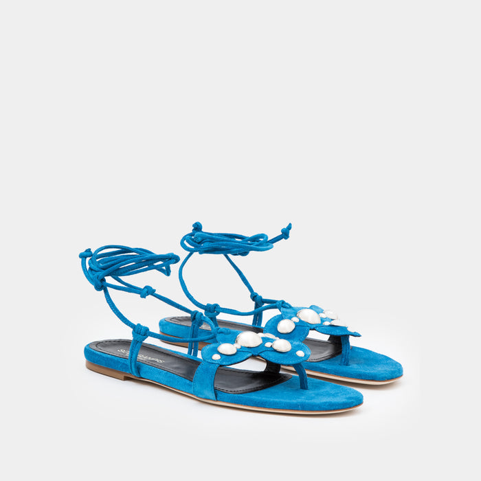 Azure Suede Oversized studded flat thong with an ankle-tie