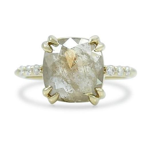 Stunning neutral rose and cushion cut diamond engagement ring set with double claw prongs and a yellow gold diamond band