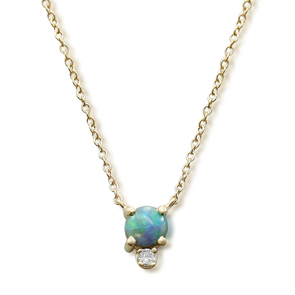 14k yellow gold black opal prong set necklace with a dainty round white diamond