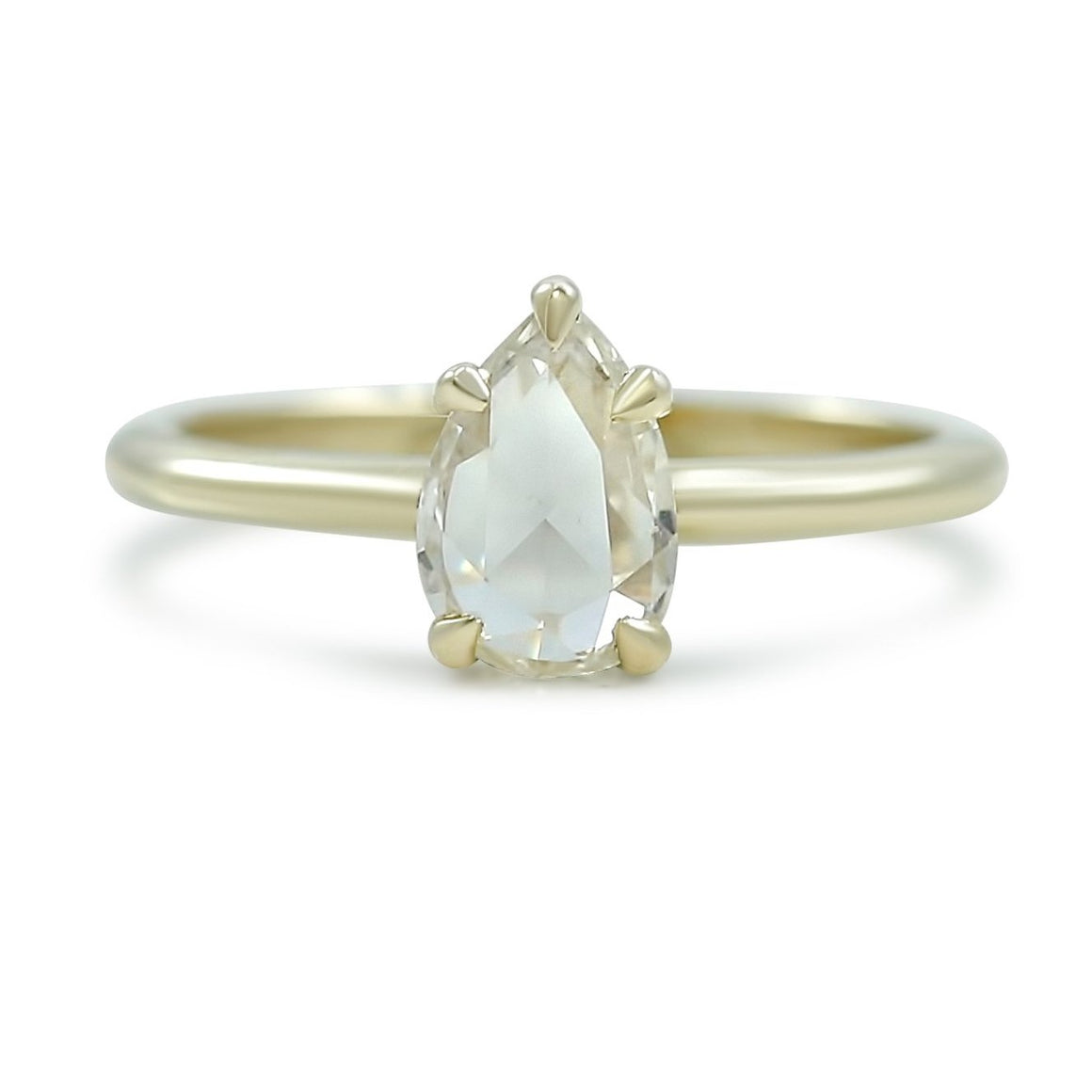 pear shaped rose cut low profile diamond engagement ring with a thin yellow gold band