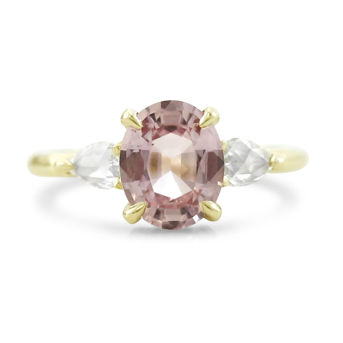 oval prong set pink sapphire engagement ring with rose cut diamond side stones 14k yellow gold