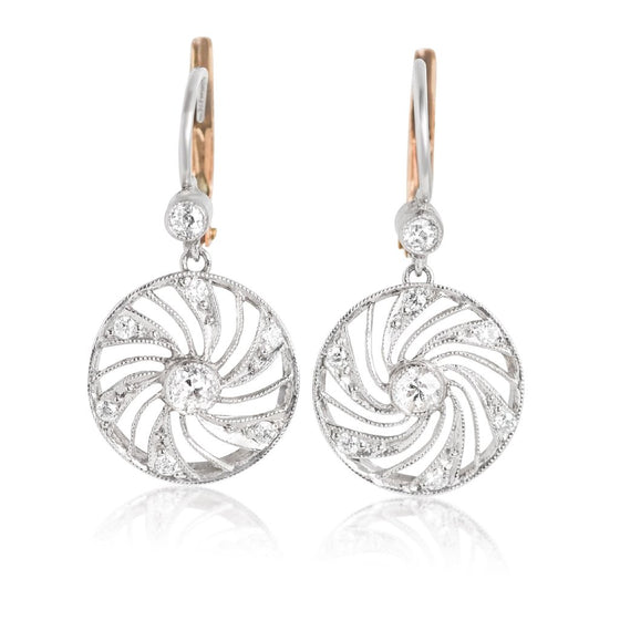 pinwheel estate diamond earrings with platinum and yellow gold