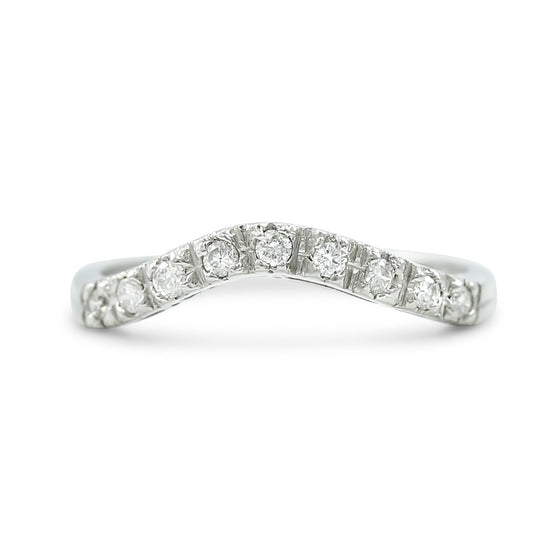 antique diamond contour band set in platinum created circa 1950s