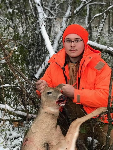 His Nephew Holding up the Buck