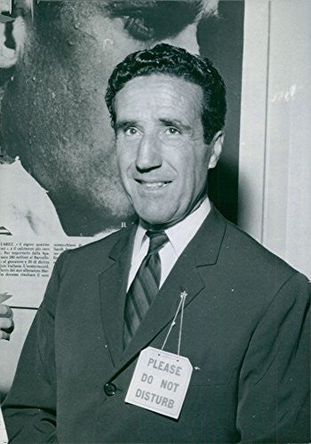 Vintage photo of Helenio Herrera smiling at the camera.