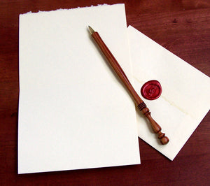 open Shakespeare card with pen and envelope showing wax seal