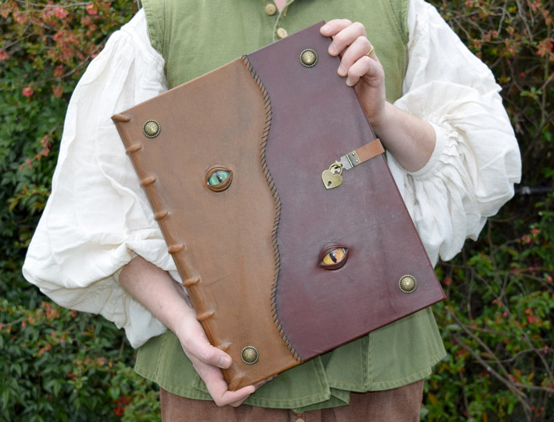 Enormous Leather Grimoire with Lock and Monster Eyes
