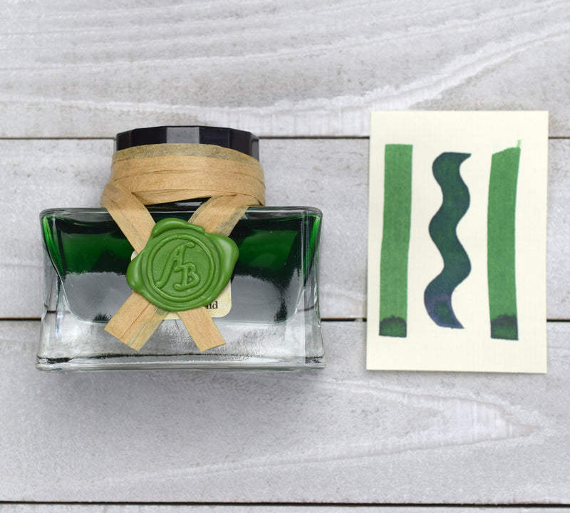 Green ink in glass bottle with wax