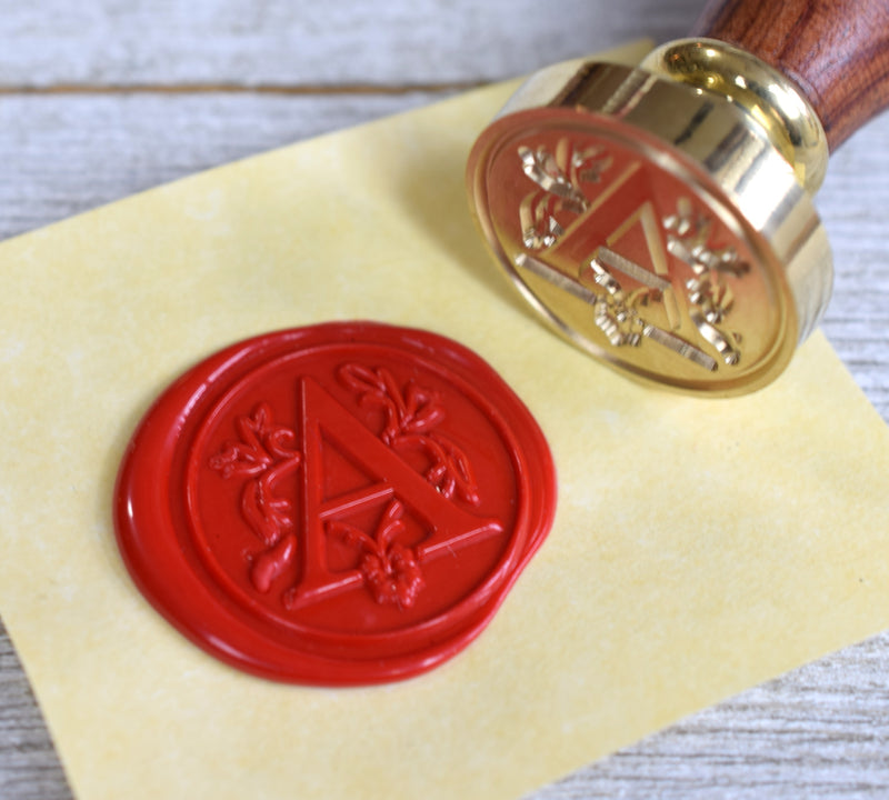 initial letter wax seal stamp with red wax
