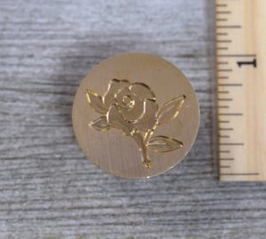 closeup of rose brass stamp head