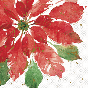 white napkin with beautiful large red poinsettia and a few small green leaves