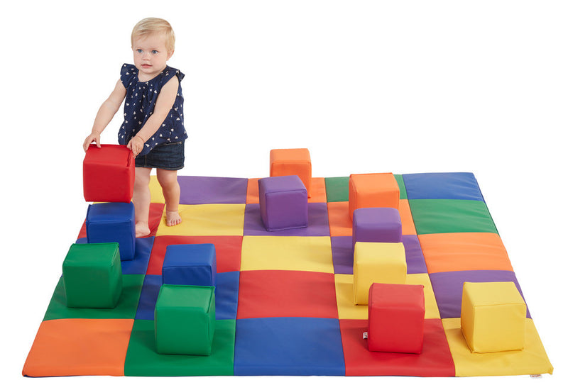 Primary colored toddler blocks and matching mat