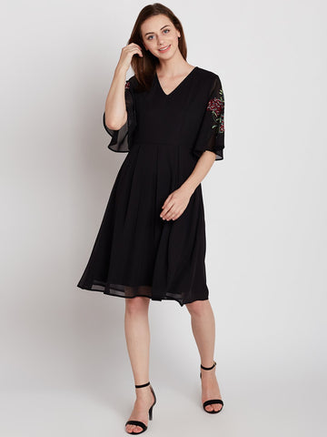 Black embroidered sleeve midi dress
