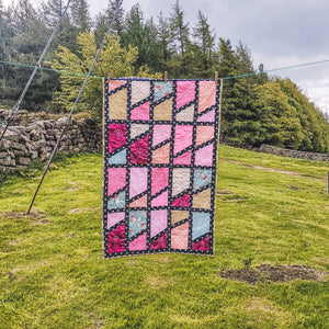 Girls Patchwork Quilt - Pink and floral based patchwork quilt with navy blue sections - Handmade in Yorkshire - Quilts by F&B - Quilts made in the UK - Patchwork
