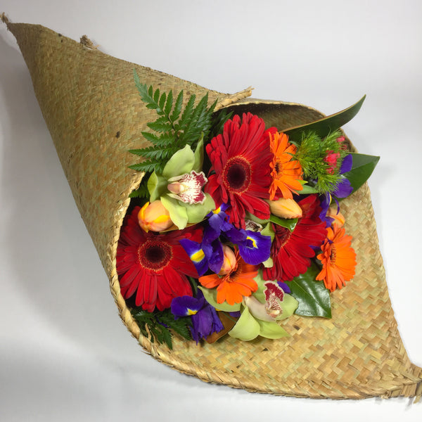Bright coloured flowers in a Porirua flax wrap
