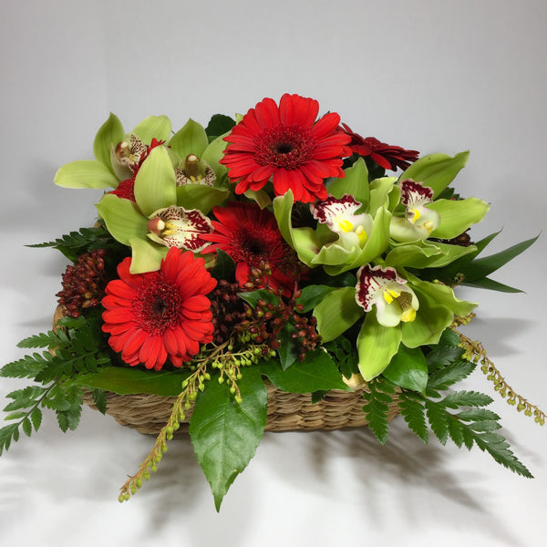 Flower basket with red and white gerberas