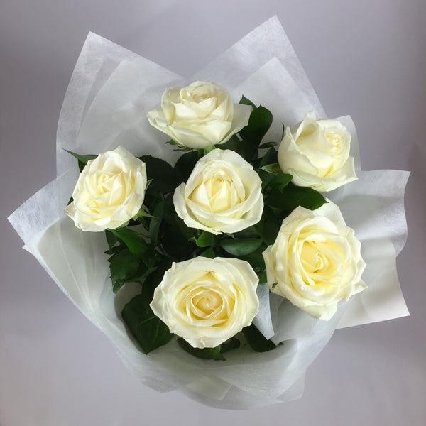 Flower bouquet of six white roses