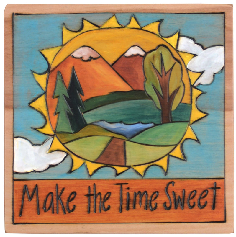 "Sticks handmade wall plaque with ""Make the time sweet"" quote and sun icon with mountain landscape within the shape"