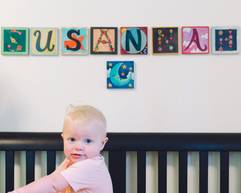 "Sincerely, Sticks printed letter plaques spelling out the name ""Susannah"""