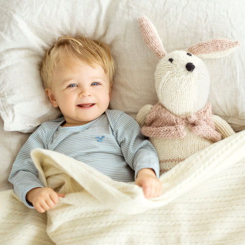 baby boy in merino with his teddy