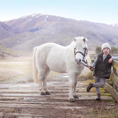boy with his pony outdoors