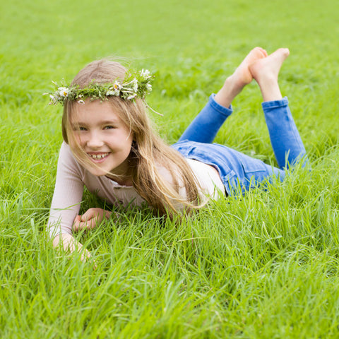 girl relaxing in the grass wearing organic merino top
