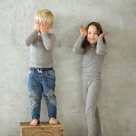 boy and girl in grey merino clothing