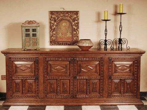 Four-door carved panel reproduction Spanish colonial sideboard / credenza, cachimbo hardwood