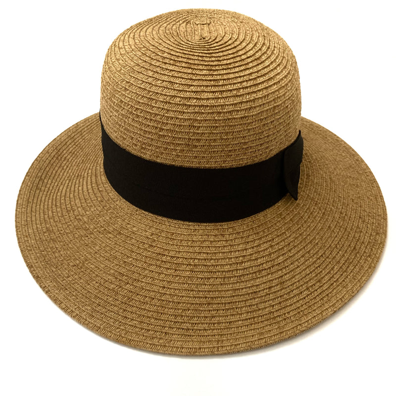 fashion forward hat, tan hat, hat with bow, wide brim hat, under $50 hat, hat is UPF 50+. Only 1/50 of the sun's UV radiation can penetrate this fabric. Blocks UVA and UVB.   The hat has a wide brim in front for more protection, a bow on the side and has a drawstring for adjustability.   75% paper and 25% polyester.