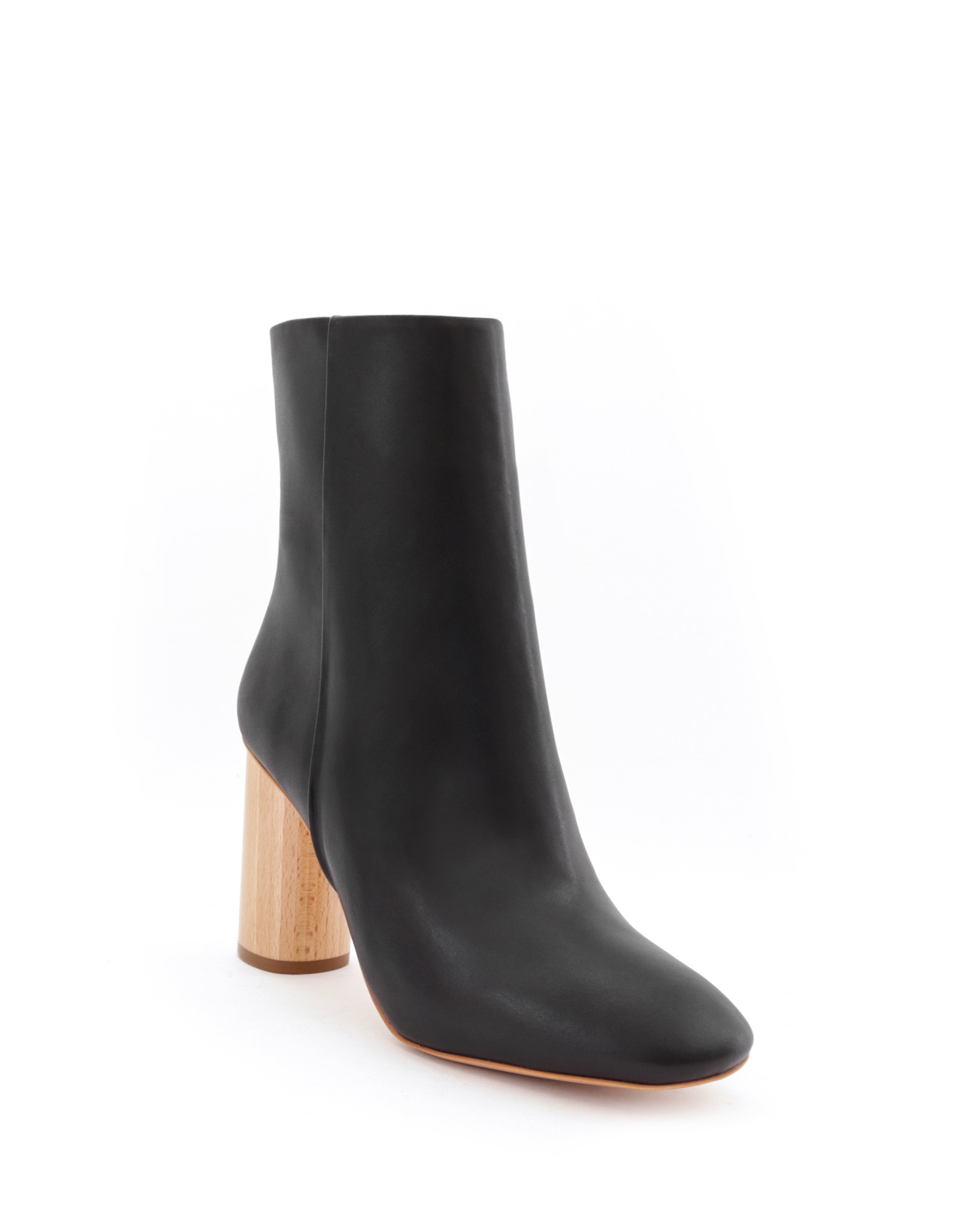 High ankle boot in eco-friendly black faux-nappa, natural sustainable wood. Luxury vegan footwear by Sydney Brown. Cruelty-free, non-leather, sustainable & ethical shoes