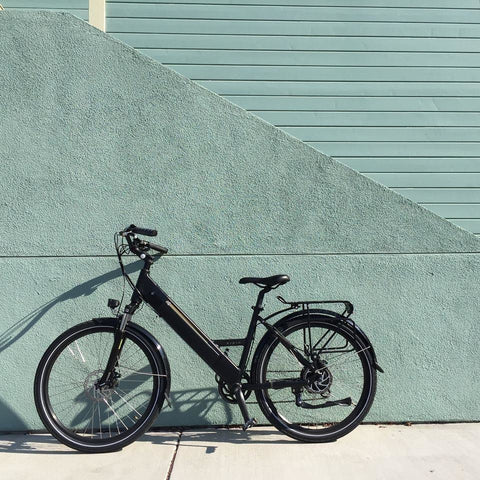 Black Espin Flow - Electric Commuter Bike - Leaning against a wall