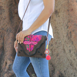 Styling with brown suede leather bag with bohemian embellishments and vintage fabric